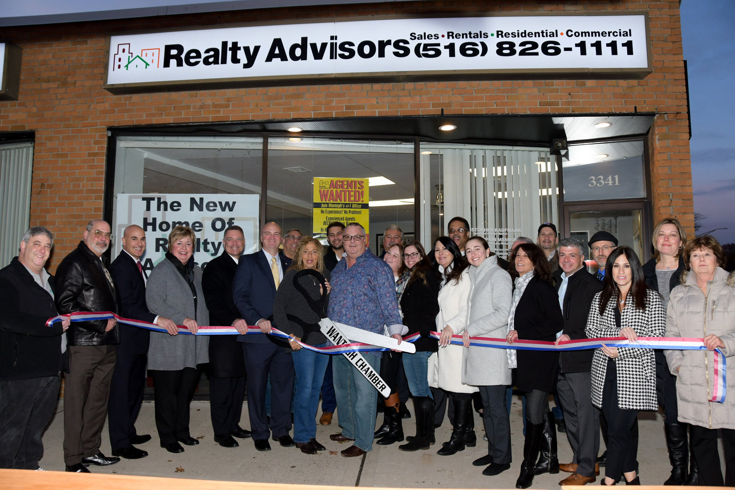 On Wednesday, Nov. 20, Realty Advsors celebrated their move from the Cherrywood Shopping Center to Park Avenue.