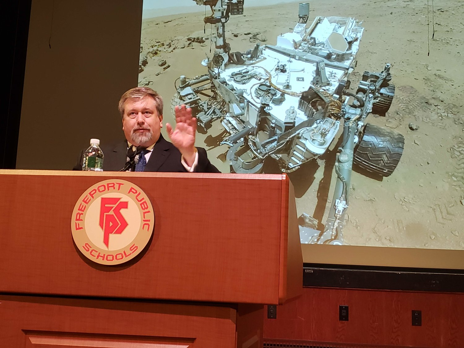 Peck displayed photos of the Mars Rover during an assembly at Freeport High's Performing Arts Center.