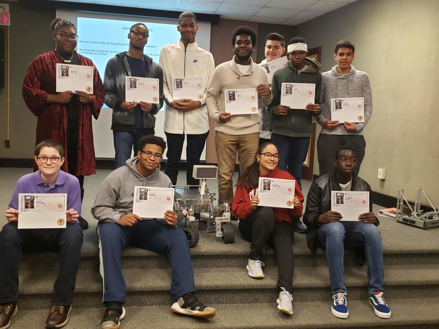 students received NASA certificates stating that their names will appear on the Rocket Atlas V-541 heading to Mars next July from Cape Canaveral, Fla.