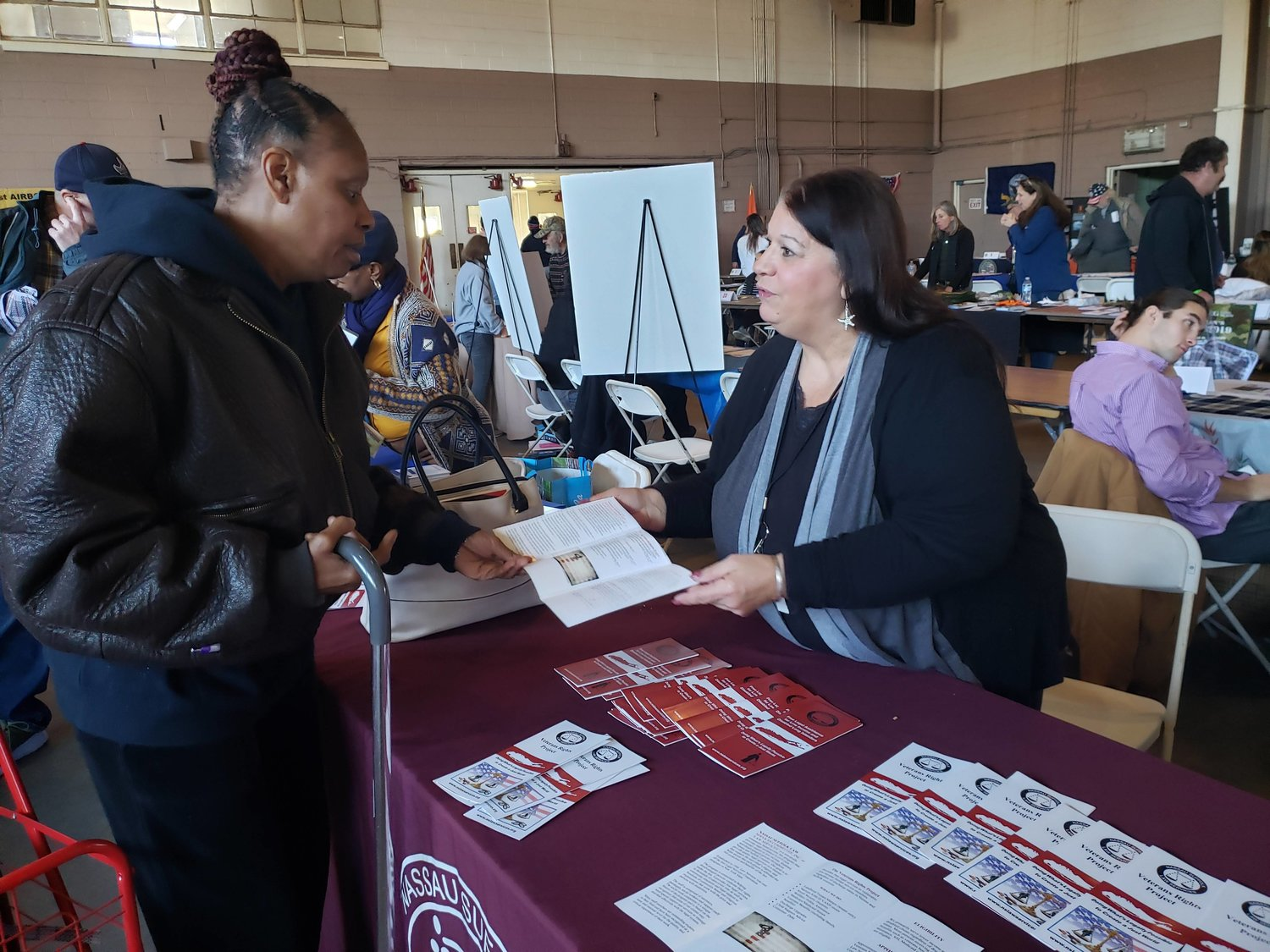 Navy veteran and Hempstead resident Gwendolyn Watson sought legal information from Dolores Scalfani a paralegal with Nassau Suffolk Law Services during the Stand Down.