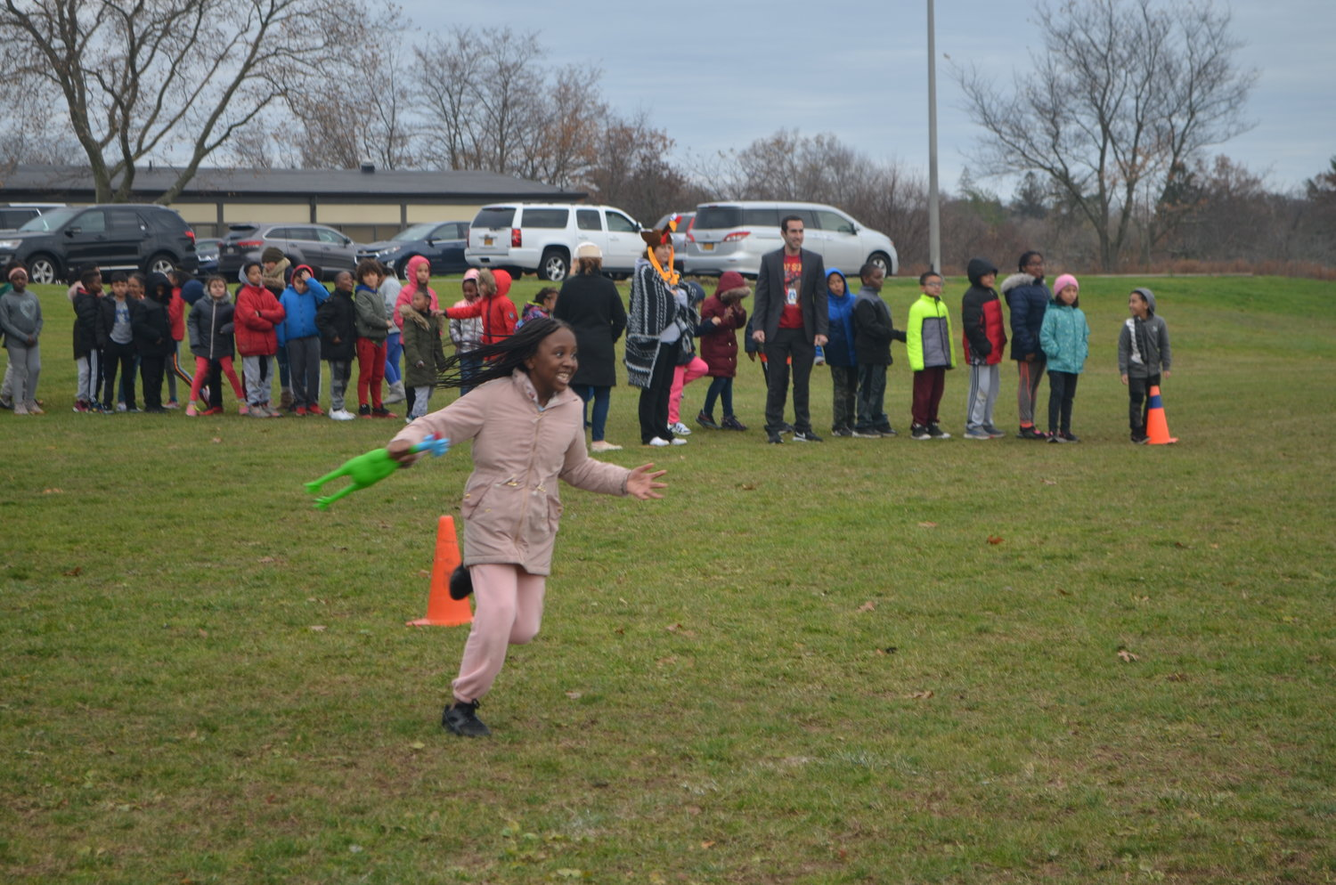 Kamryn Johnson, a Brookside Elementary School student from Mrs. Seltzer's third grade class, ran with a rubber chicken as part of the school's first Turkey Trot.