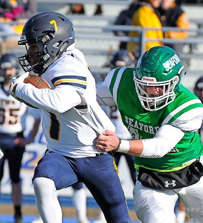 Shoreham quarterback Xavier Arline, left, proved too much for Seaford in last Saturday's Long Island Class IV championship game at Hofstra.