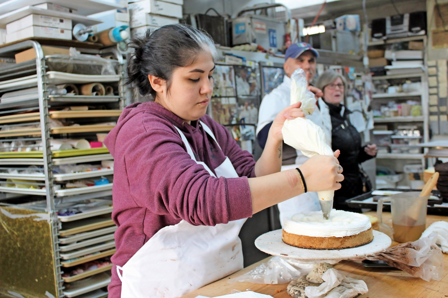 Kathryn McCusker iced a cake at the Sapienza Bake Shop on Nov. 29.