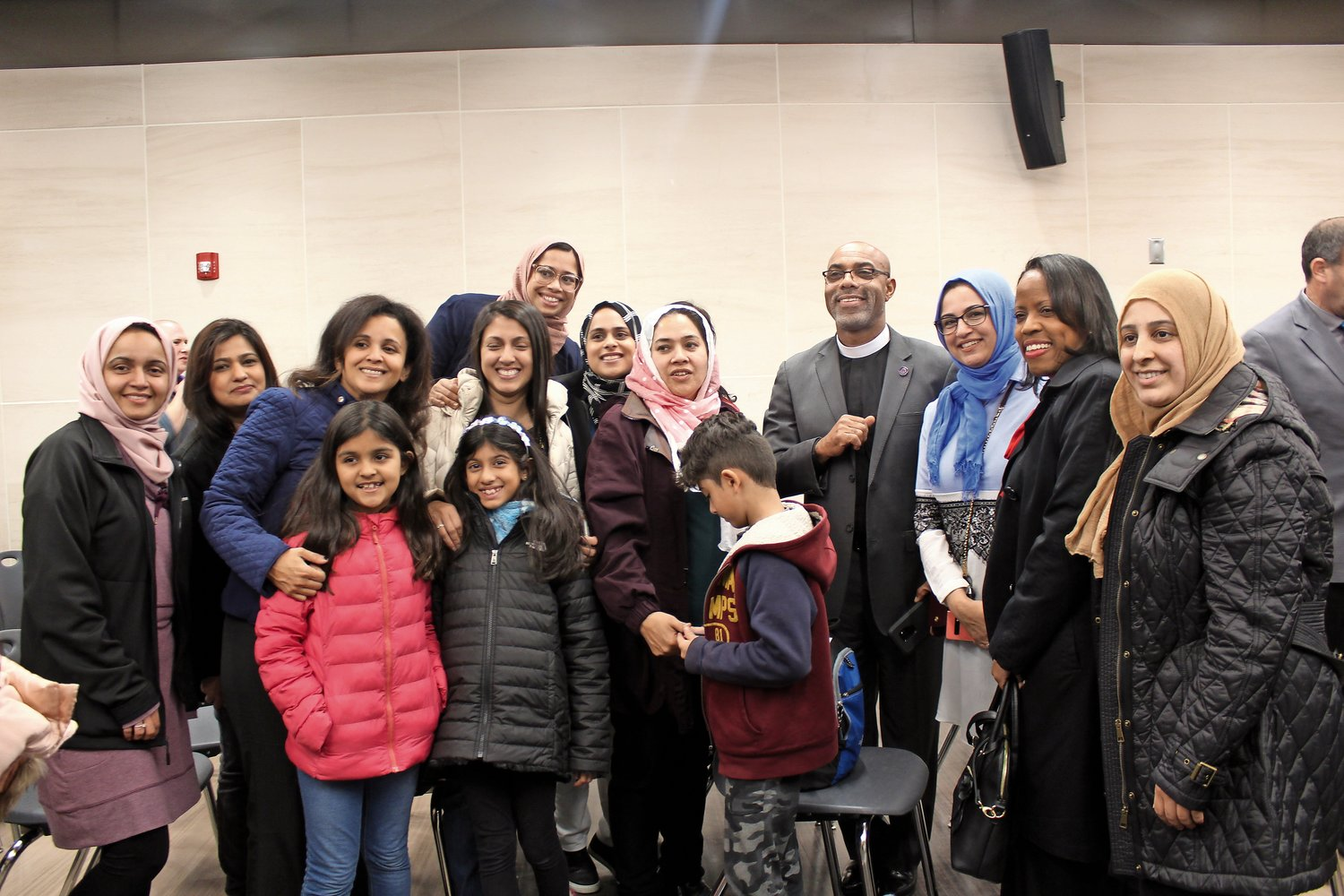Muslim students and parents petitioned the Sewanhaka Board of Education to include the Eid holidays on the calendar next year. They were supported by the Rev. Danilo Archbold, pastor of New Jerusalem Pentecostal Church in Elmont, fourth from right.