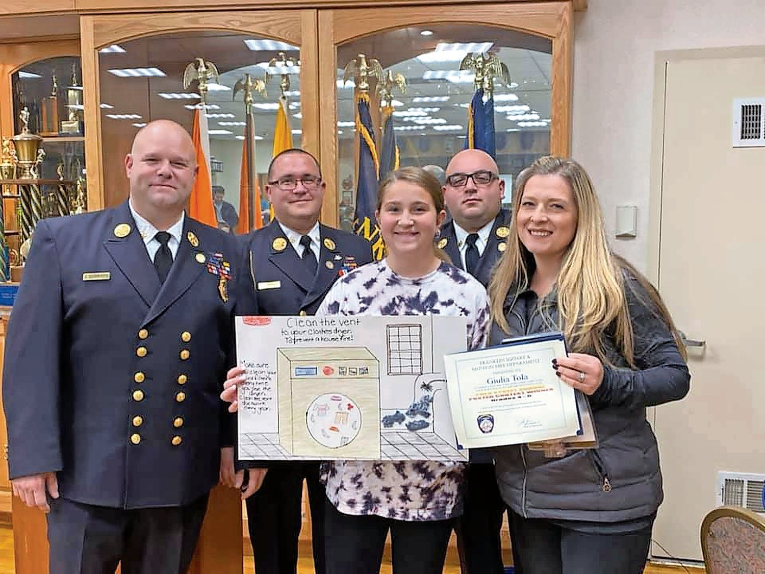 Giulia Tola, third from right, a student at the Polk Street School, was recognized for her poster about the dangers of lint.