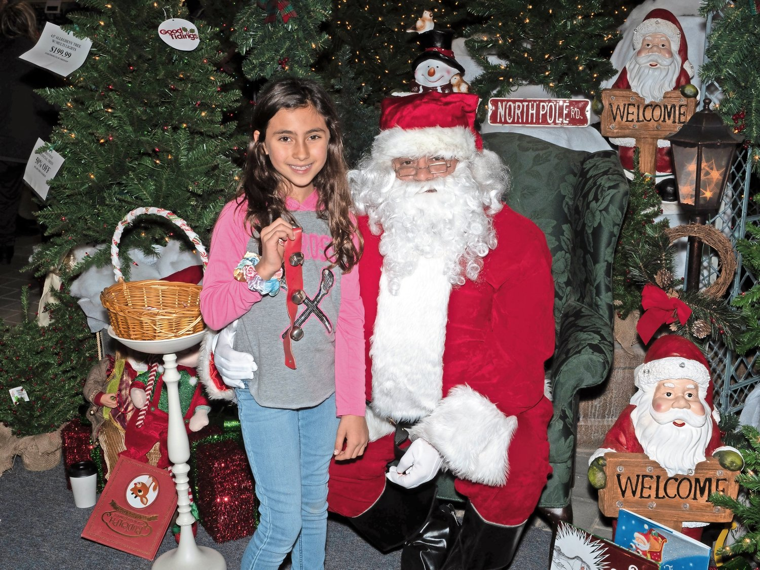 Emma Essig, 8, told Santa Claus what she wanted for Christmas at Garden World's tree lighting on Dec. 1.