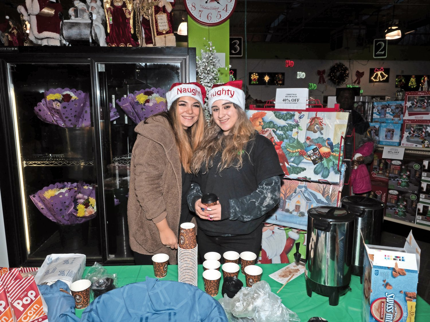 Christina Lisio and Nicole Napolitano handed out hot apple cider.