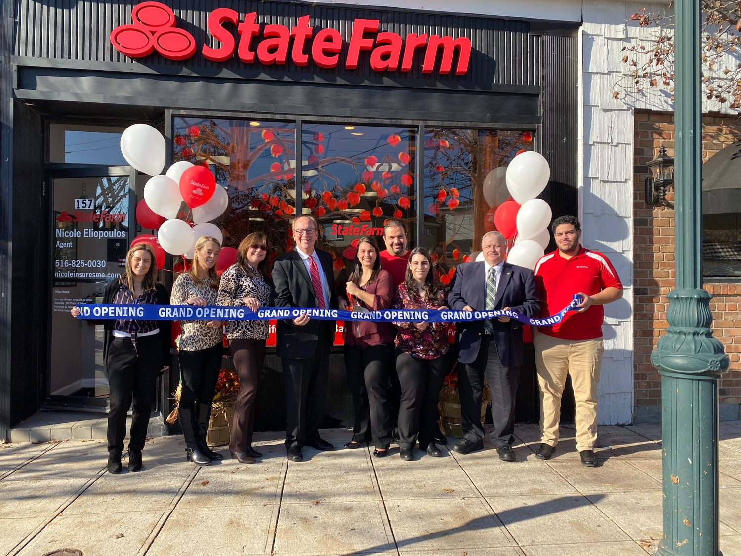 Celebrating the opening of a State Farm office in Valley Stream were from left Shana Milillo, Carolyn Argento and Heather Norman, both of Coach Realtors, HWBA President David Friedman, owner/agent Nicole Eliopoulos, her husband Jason Eliopoulos, Anastasia Aristotle, Larry Lombardo, an assistant to County Legislator Bill Gaylor and Miguel Reyes.