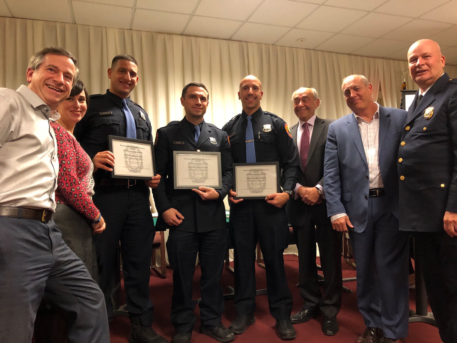 Four Nassau County 4th Precinct officers were honored at the Nov. 14 Lawrence village meeting. From left were Trustees Uri Kaufman and Syma Diamond,  officers James LaRocca, Edmund Demeo and James Kyriakoy, Mayor Alex Edelman, Trustee Daniel Goldstein and 4th Precinct Commanding Officer Insp. Joseph Barbieri.