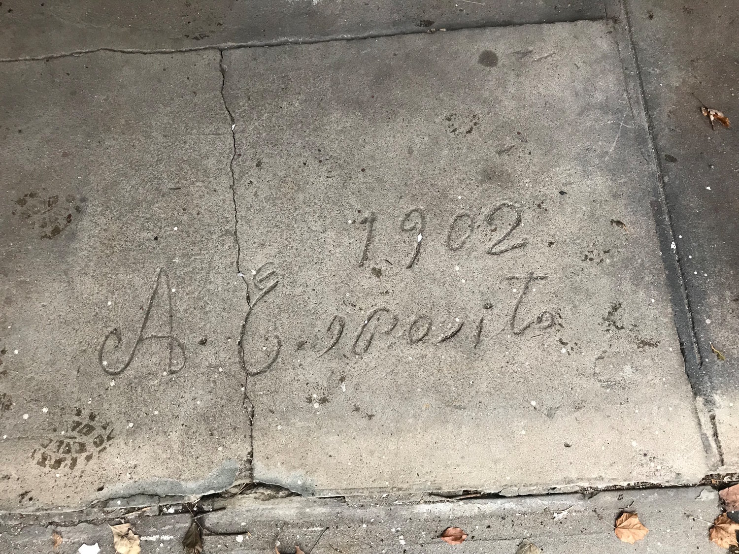 In the stable, someone scrawled an illegible signature and the year, 1902, in the concrete.