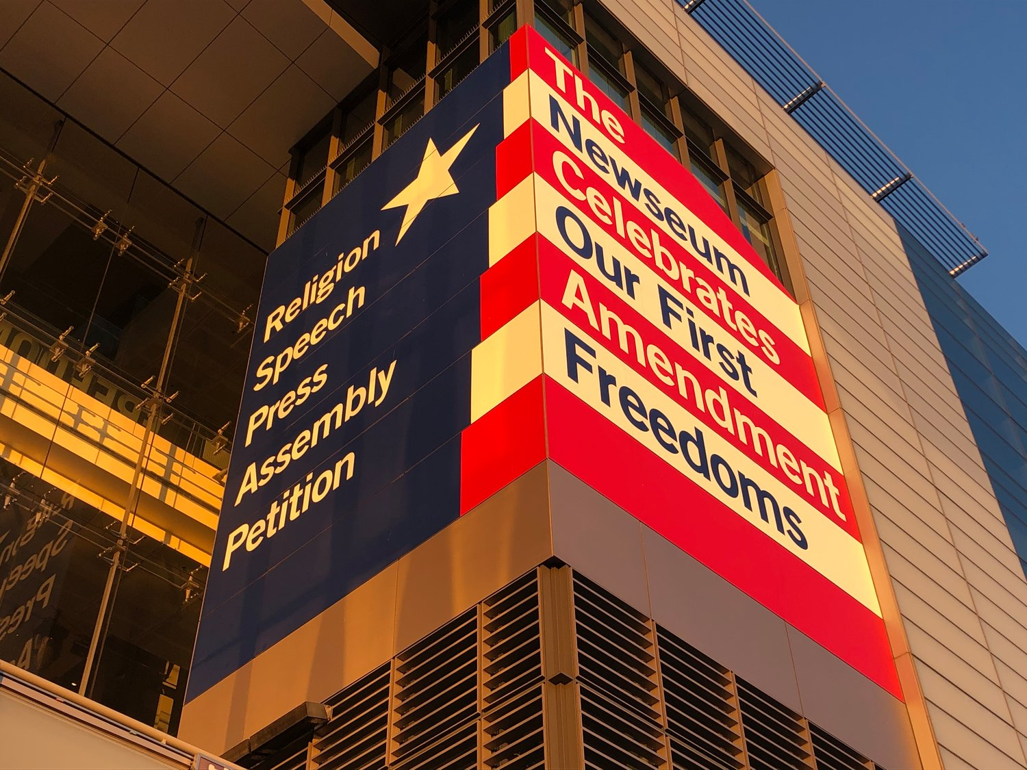 Panels on the façade of the Newseum remind the public of the five freedoms guaranteed by the First Amendment: religion, speech, press, assembly and petition.