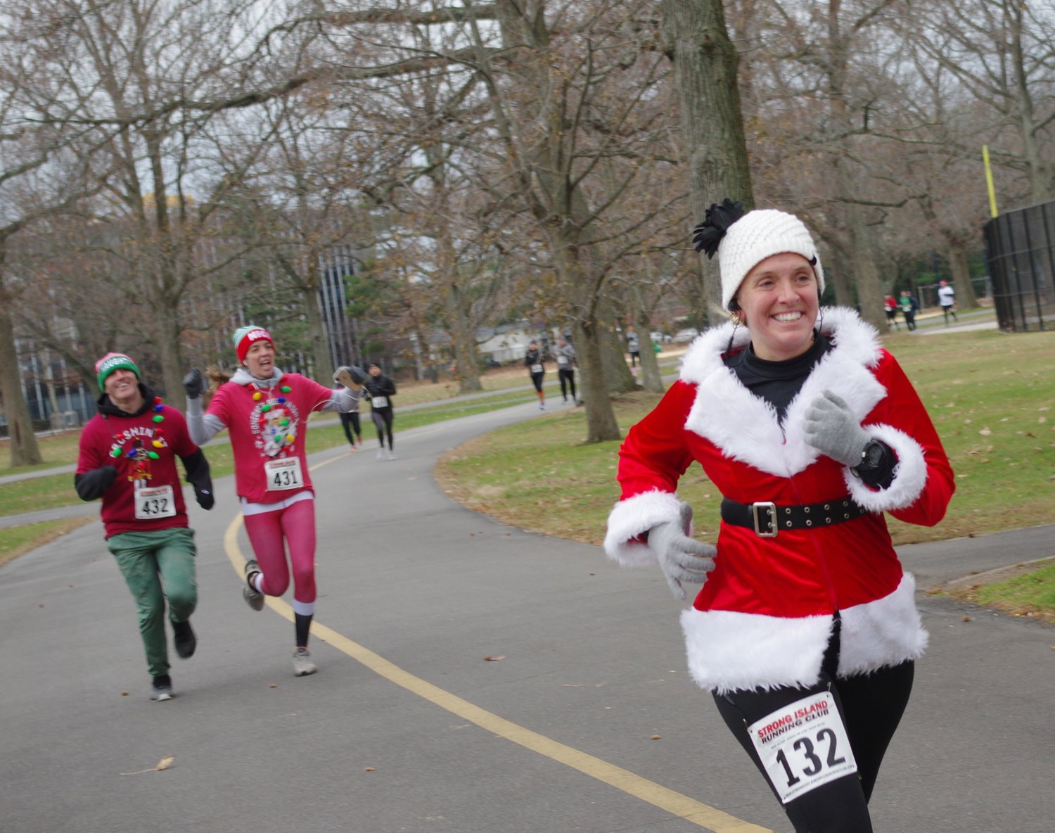 Dawn Konopka, 40, joined dozens of runners who dressed as Santa Claus or other festive winter characters as they took part in the League of YES's third annual Santacon 5k Run, Walk and Roll at Eisenhower Park on Dec. 1. Following behind her was Joe Mascaretti, 35, and Maureen Marzano, 32, both of Rockville Centre.