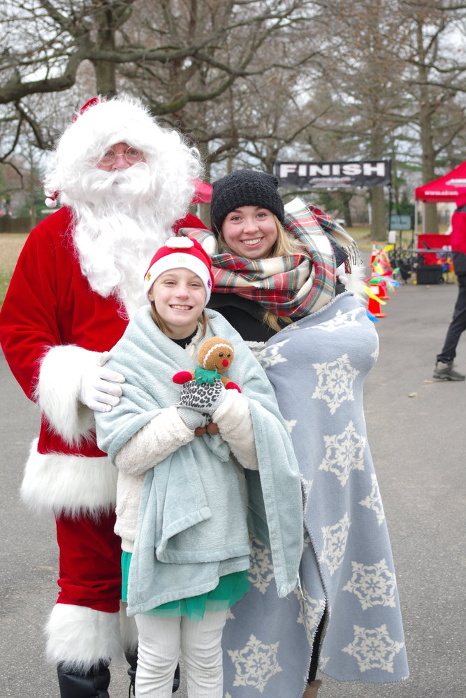 Grace O'Sullivan, Evelyn Boyle, 9, and Kevin O'Sullivan dressed in festive winter costumes for the League of YES's third annual Santacon 5k Run, Walk and Roll at Eisenhower Park on Dec. 1.