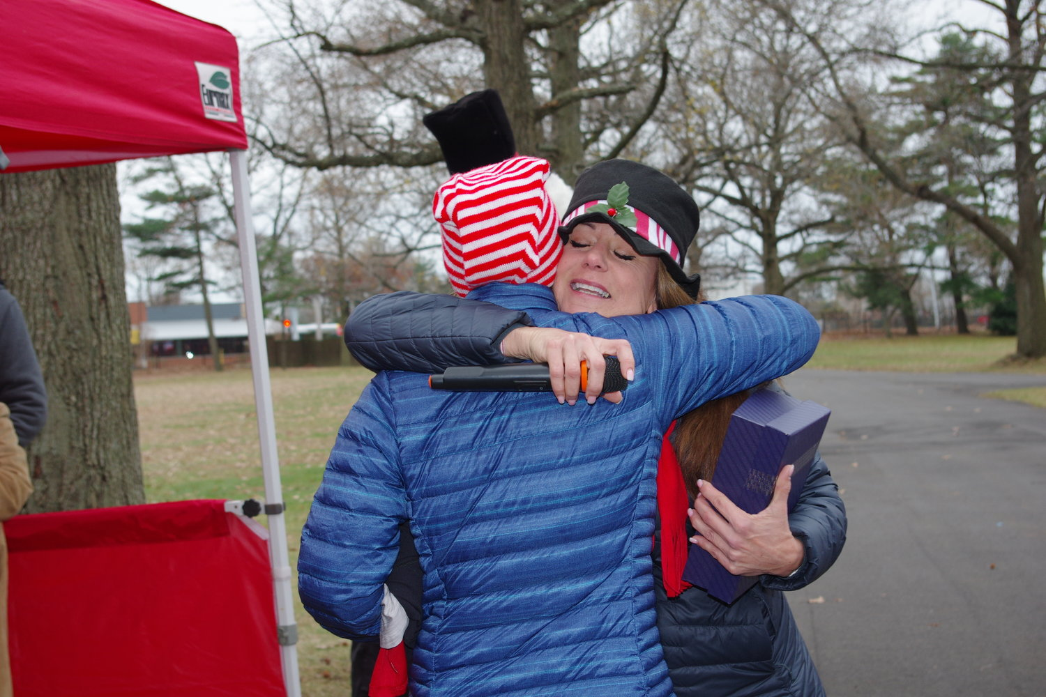 League of YES President Christine Fitzpatrick hugged first-place winner Bea Huste-Petersen, 55, of East Islip, after she crossed the finish line.