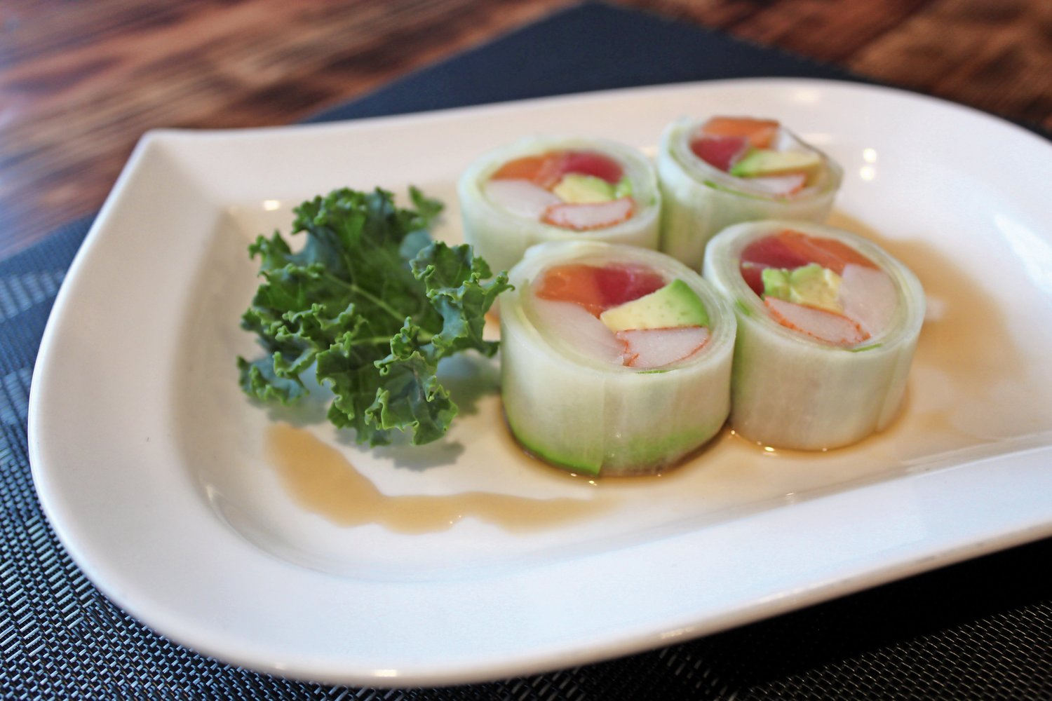 Fuji Seoul's rainbow naruto roll features tuna, salmon, whitefish, crab and avocado wrapped in thin slices of cucumber.