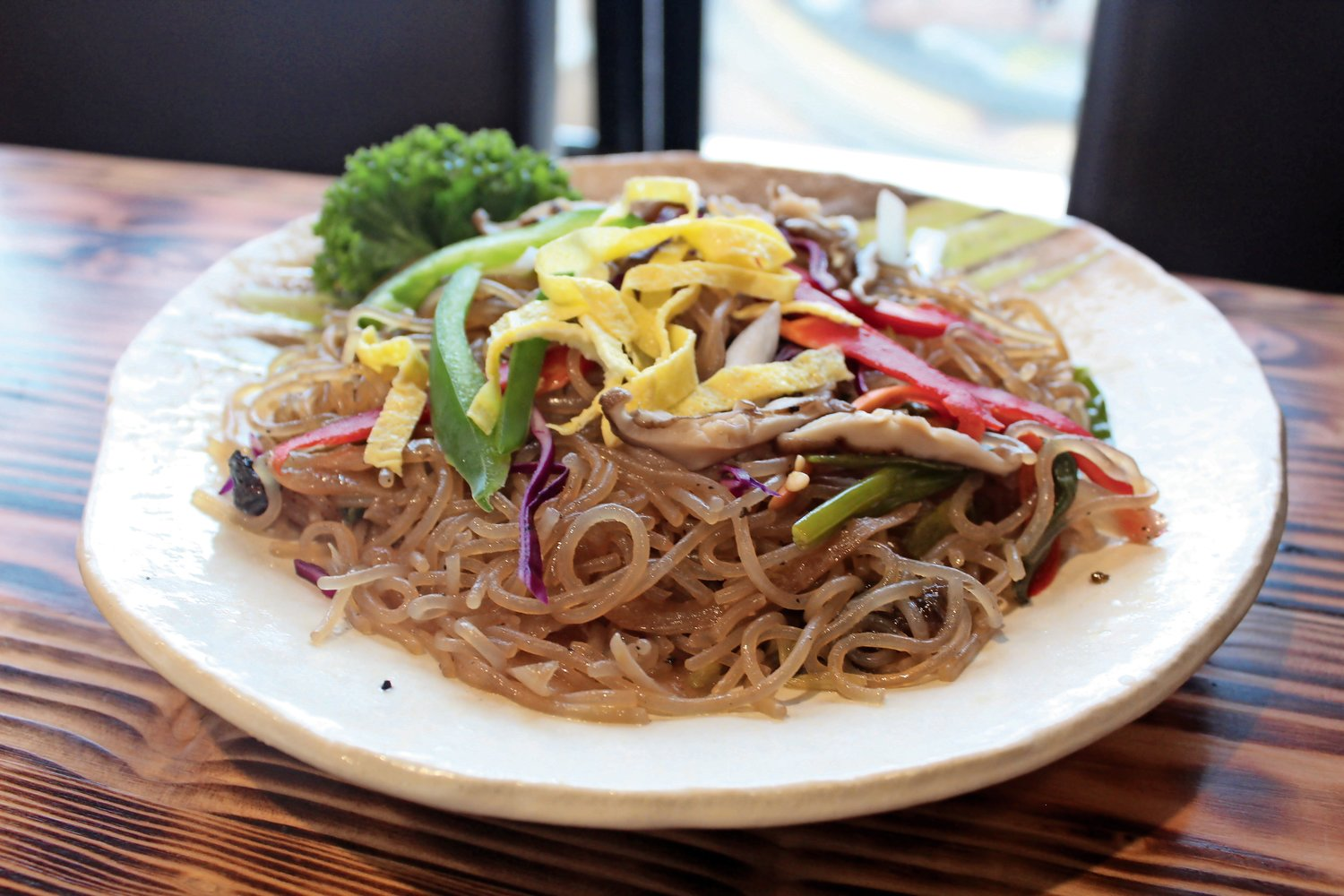 Fuji Seoul's iteration of japchae, a popular Korean dish, features sweet and savory stir-fried glass noodles and vegetables.