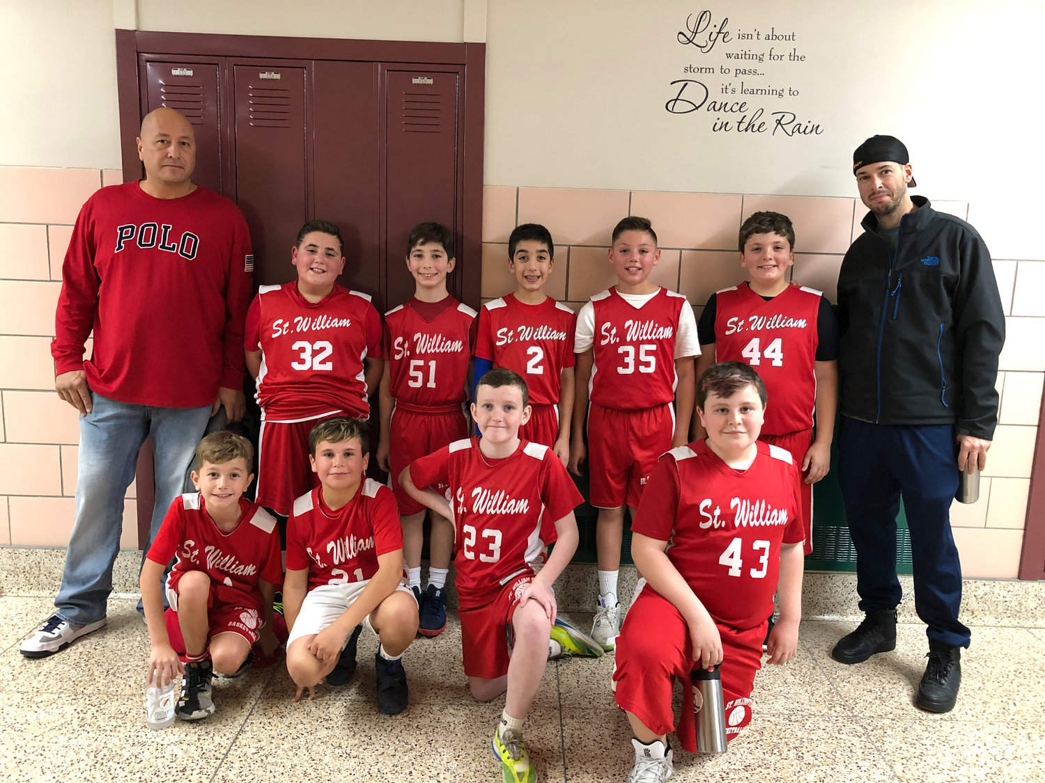 Coach JOE Marino, left, with the St. William fifth-grade boys' basketball team after their 22-20 overtime thriller loss to St. Bernard.
