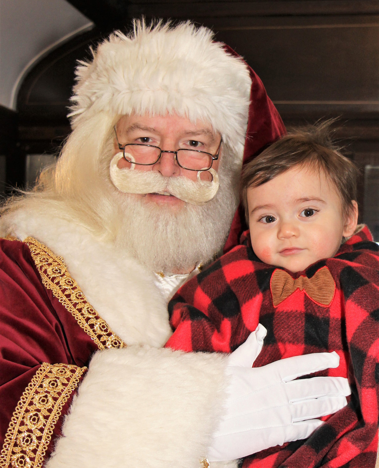 William Paulafox, 9 months old, was treated to a visit from Santa Claus, who posed for photos aboard the Polar Express with everybody who waited in line. Story, more photos, Page 3.