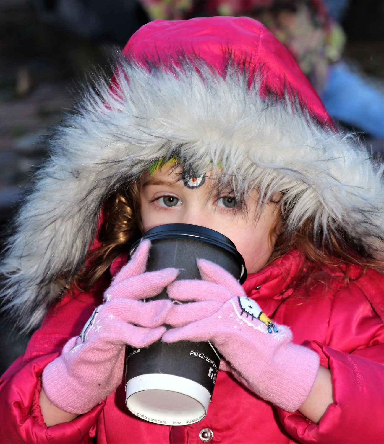 Hot beverages like coffee and hot chocolate were served to fend off the bitter chill in the air on Saturday, Nov. 30 at the Wantagh Preservation Society. Mackenzie Henshay, 31/2, kept warm sipping hot cocoa.