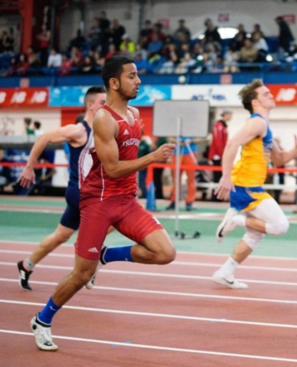 Justin Budhu runs track at Freeport High School and has participated in the 2018 Junior Olympics held in Iowa.