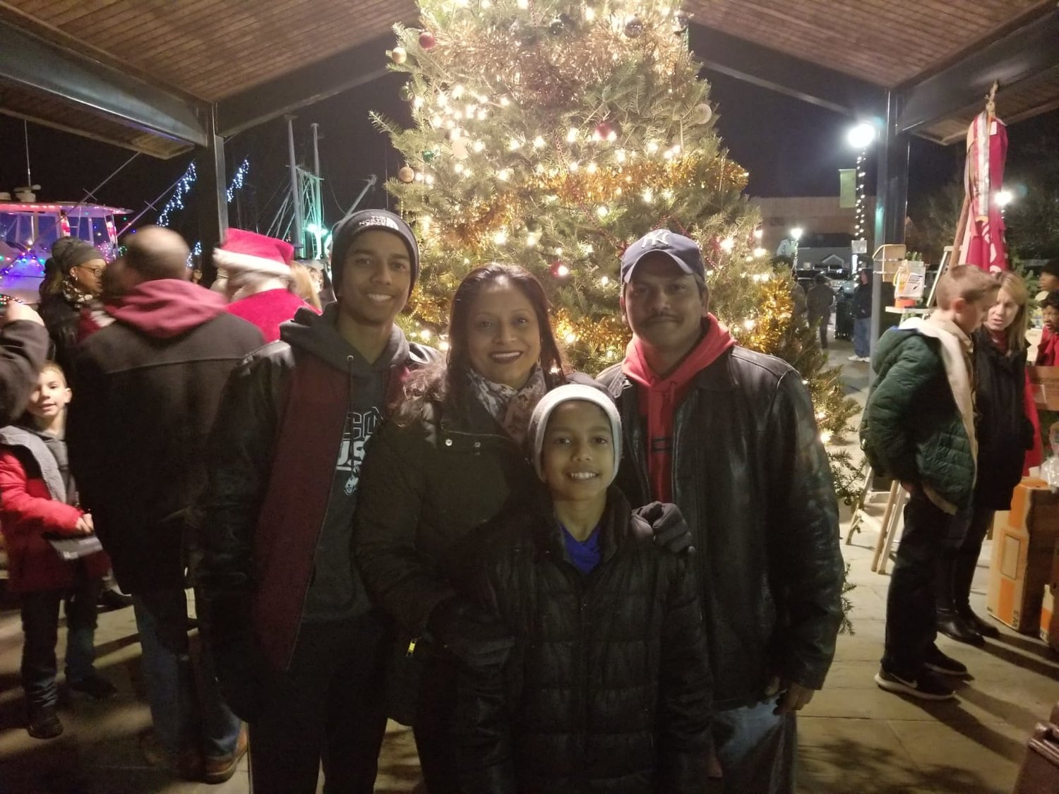 The Budhu family, Justin, left, Joanna, Jayden and John, right during the holiday seasons at the Esplanade on Woodcleft Avenue in Freeport.