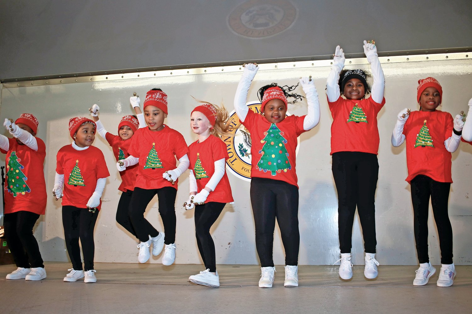 "Tip Tap Toe dancers performed to ""Go Go Christmas"" at the Elmont Chamber of Commerce Christmas tree and menorah lighting on Dec. 4."