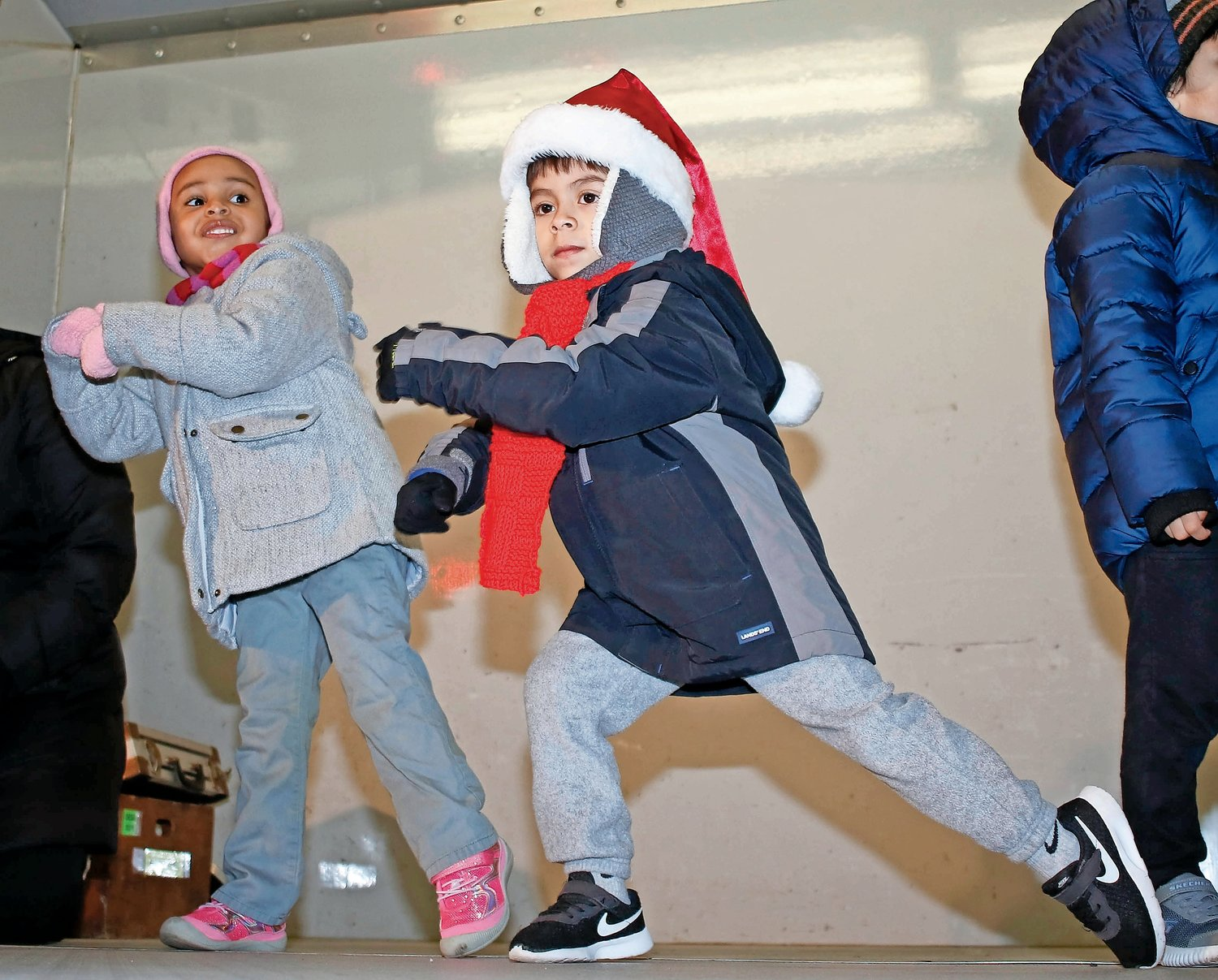 "Meecham Childcare performers, Ylanna Guzman and Mateo Lopez, both 4, danced to ""Here Comes Santa Claus"" and ""Feliz Navidad."""