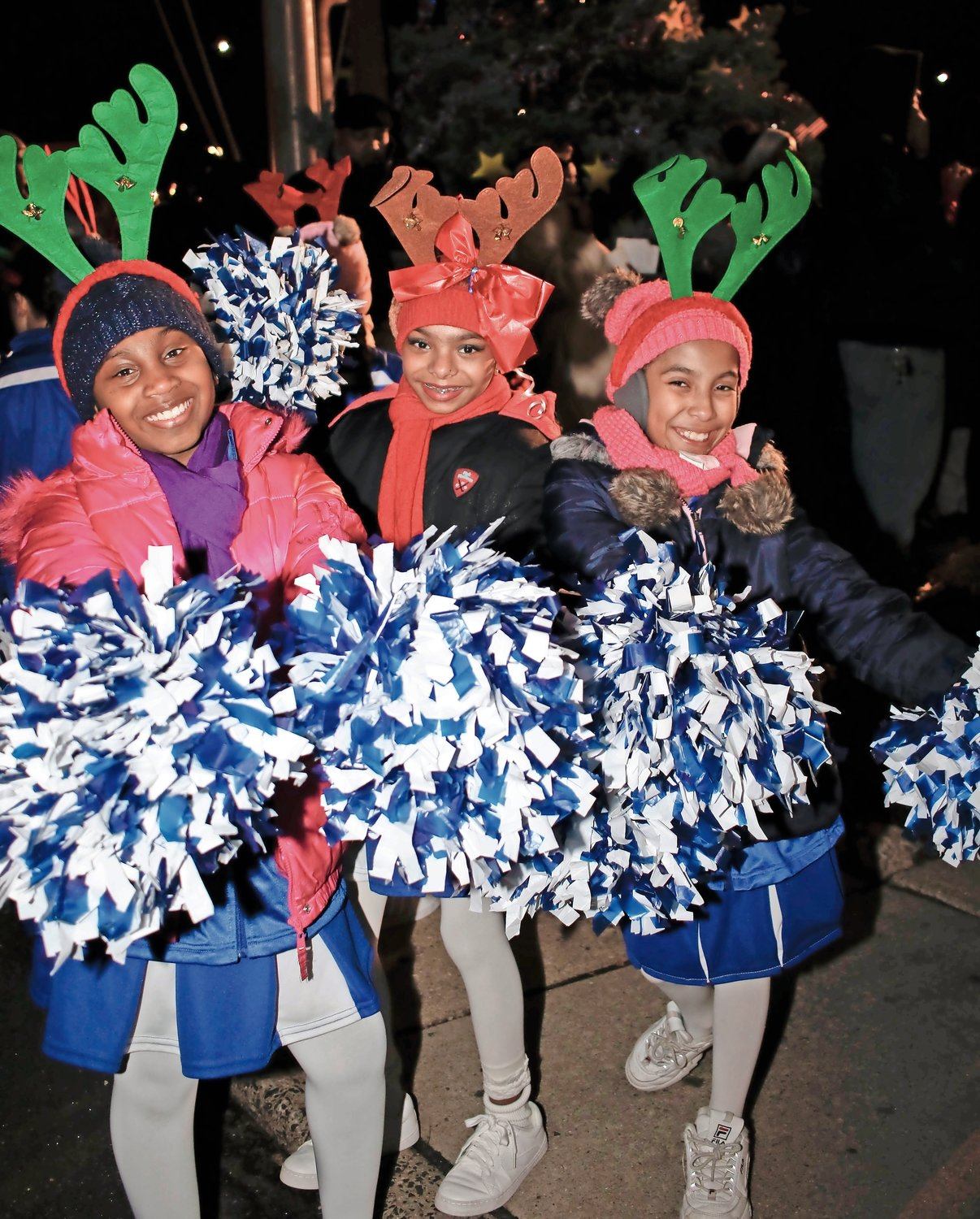 "The Elmont Dazzlers, Nia Appleby, 11, Evangeline Moonsammy, 11 and Ariana Lopez, 10, donned their antlers before performing to a hip hop remix of ""Sugar Plum Fairy."""