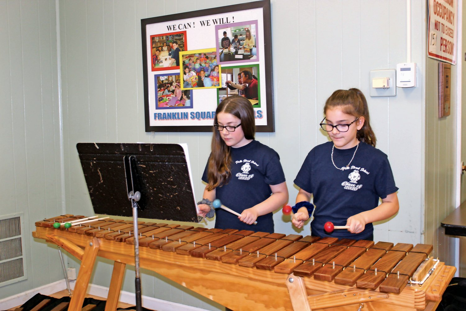 Polk Street sixth-graders Siobhan Knoedler and Victoria Kennedy demonstrated what they have learned on the marimbas.