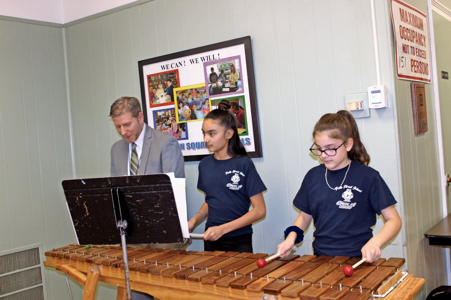 Superintendent Jared Bloom joined Isabella Wick and Victoria Kennedy on the marimbas at the Franklin Square School District Board of Education meeting on Dec. 4.