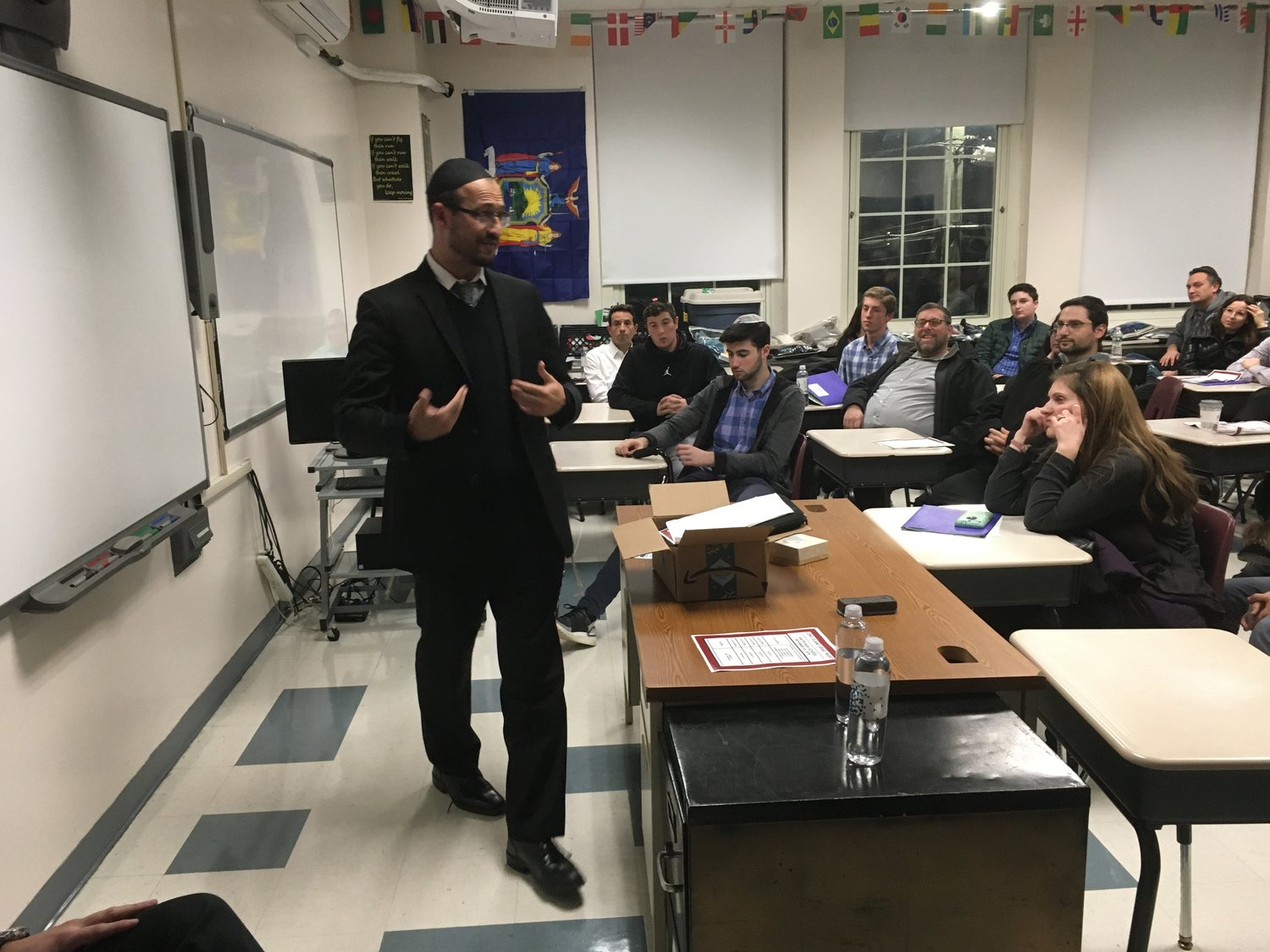 Avi Schneider, Assistant principal of the Jerusalem-based yeshiva Torat Shraga, spoke to parents and students about the school at the Long Island Israel night hosted by HAFTR High School last month.