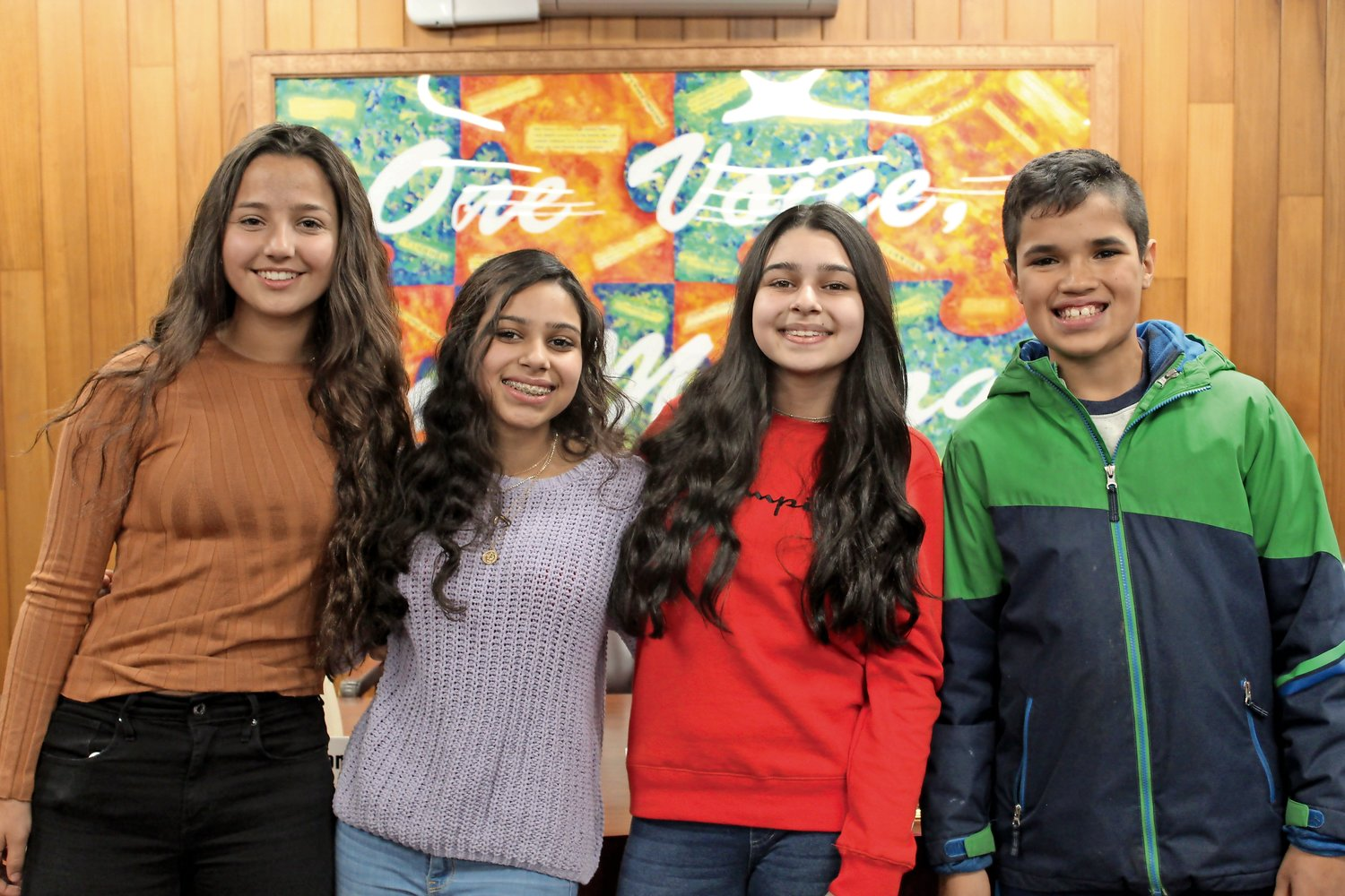 Merry Tuurmann, left, Alisha and Summer Marfani and Amir Ibrahim attended Bellmore-Merrick Central High School District's Board of Education meeting on Dec. 4, and implored the board to add Eid al-Fitr and Eid al-Adha, two Muslim holidays, to the school calendar.