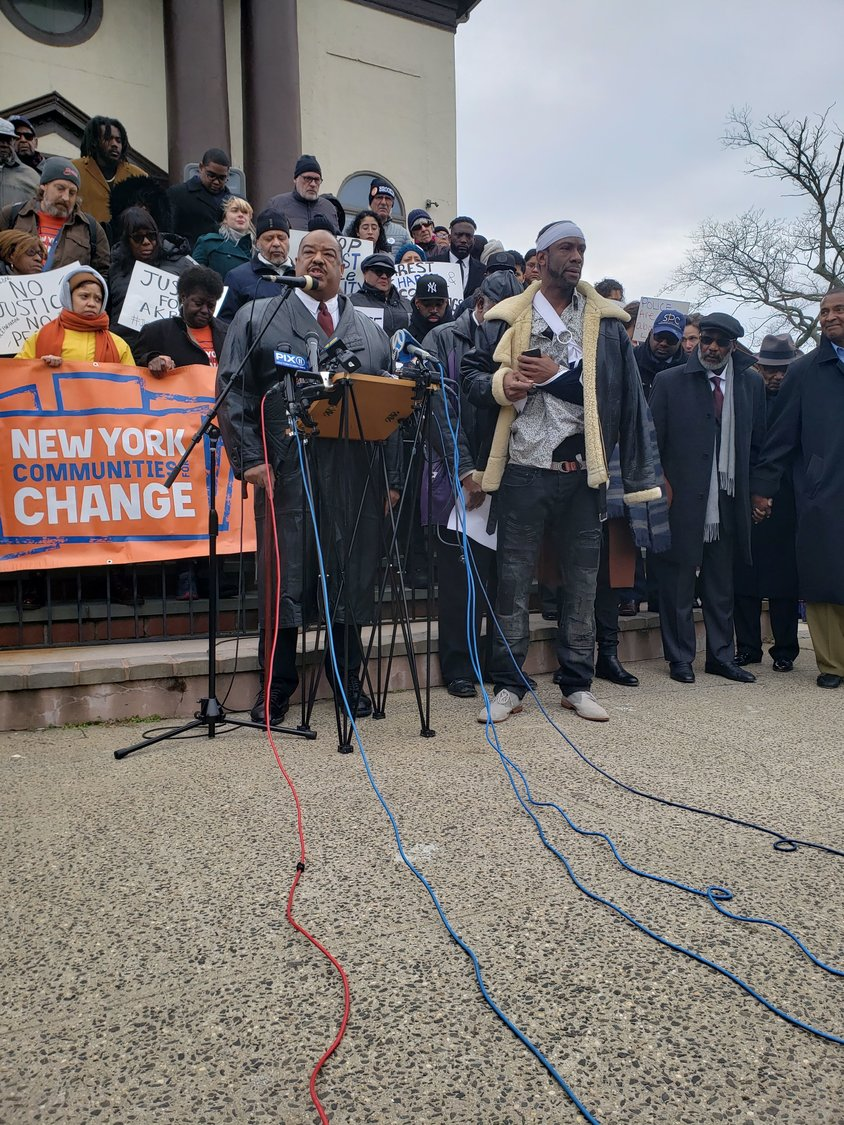 The Rev. Arthur Mackey, Jr., at lectern, at a protest on Dec. 6, along with Akbar Rogers, days after Rogers's controversial arrest. Rogers is suing the Village of Freeport and Nassau County for $25 million.