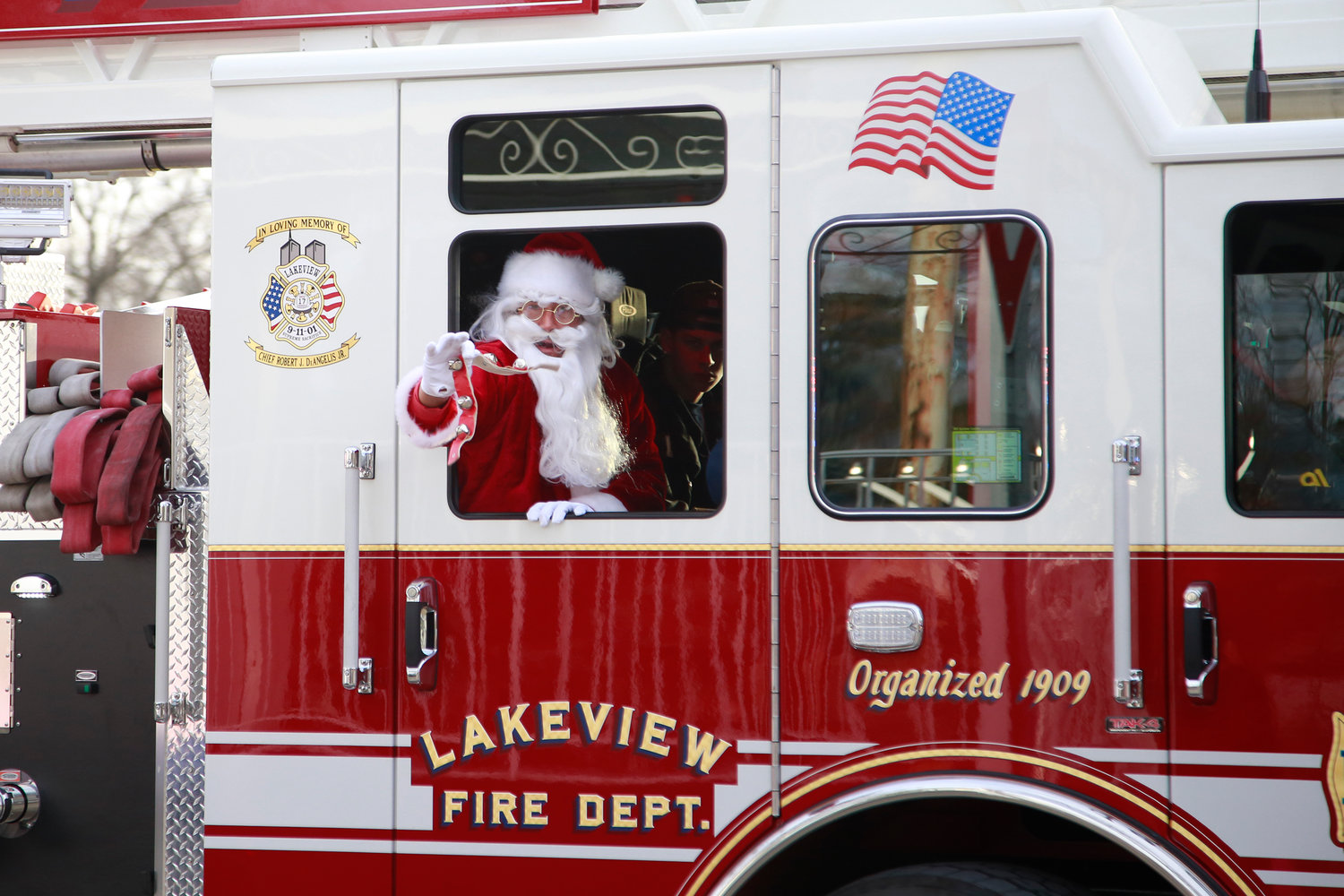 Santa Claus arrived to Holiday at Halls in a fire truck from the Lakeview Fire Department.