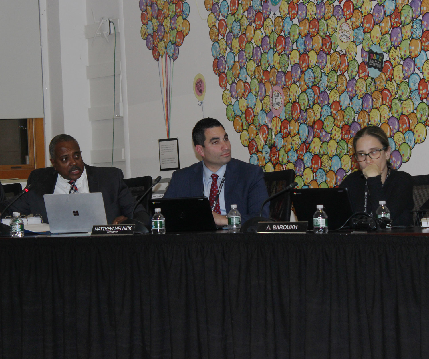 At a Board of Education meeting on Dec. 4, the district revisited the option of installing artificial-turf fields at East Meadow High School and the Leon J. Campo Salisbury Center, which is used by W.T. Clarke middle and high schools. From left were Superintendent Kenneth Card Jr., board President Matthew Melnick and Vice President Alisa Baroukh.