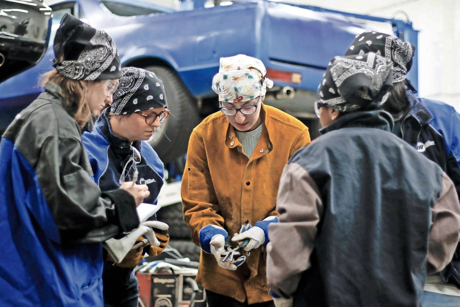 Instructor Pauline Badamo, center, showed the class how to use MIG pliers, and explained what they are used for.