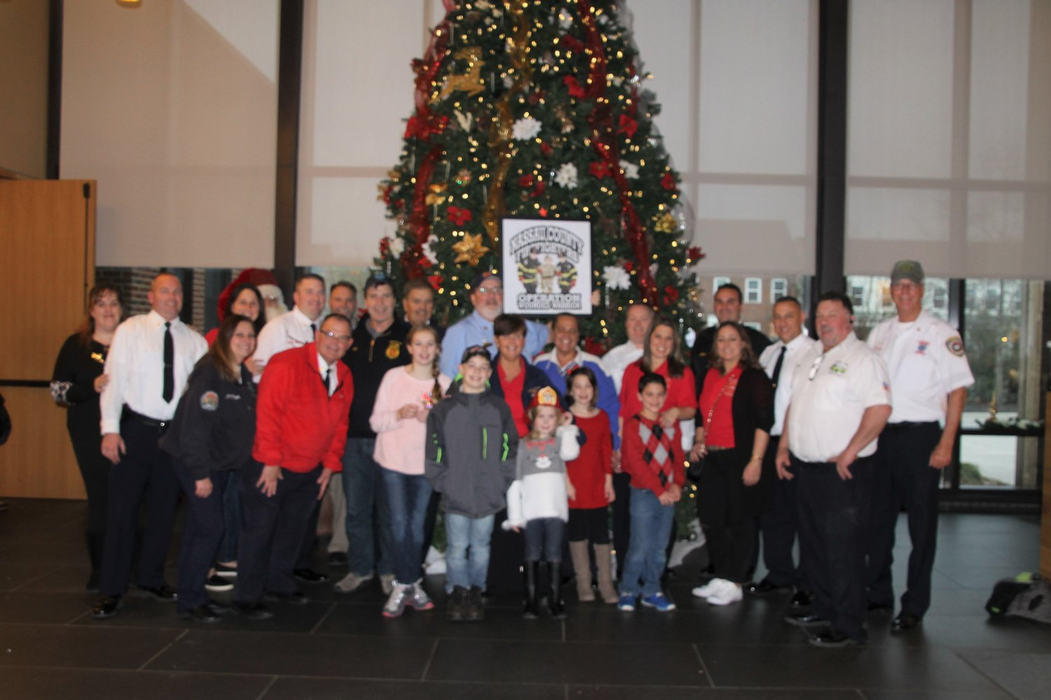 A group of Lynbrook firefighters visited wounded soldiers in Virginia and gathered around a Christmas tree.