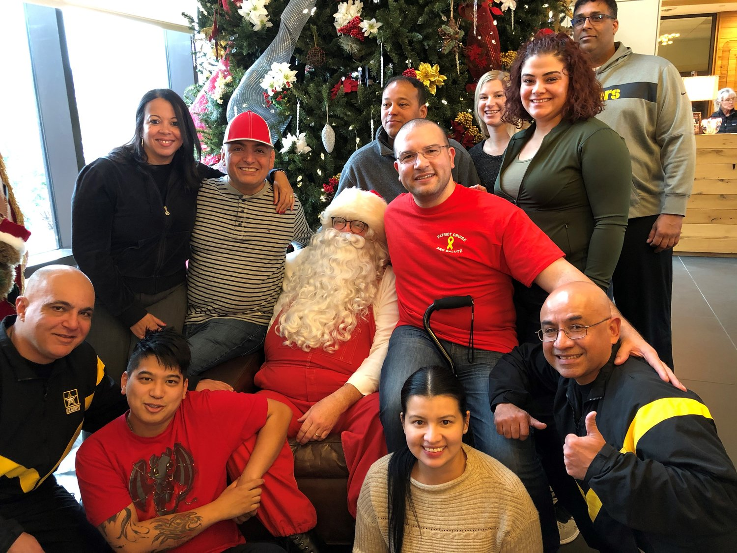 A group of wounded warriors from Fort Belvoir, in Virginia, and their family members visited with a firefighter Santa Claus during Lynbrook and other Nassau County firefighters' visit to the wounded at Christmas time.
