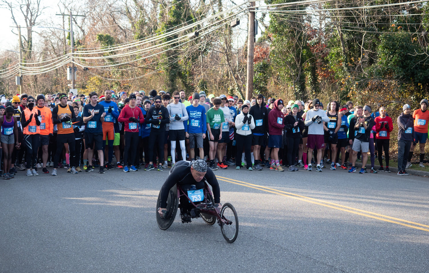 Wheelchair athlete Peter Hawkins, 55, of Malverne was given a 15-second head start as the rest of the field watched before the race officially began.