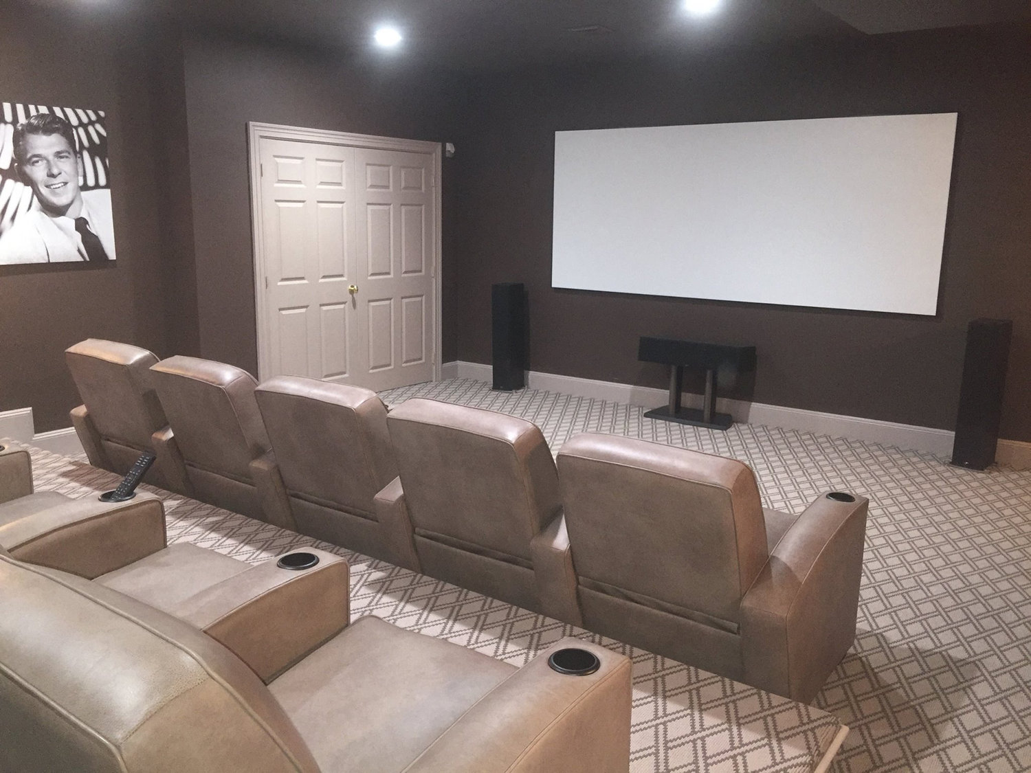 Seaford's Sights N Sounds specializes in audio-visual installations, and works alongside interior designers to renovate spaces like this theater in Southampton.