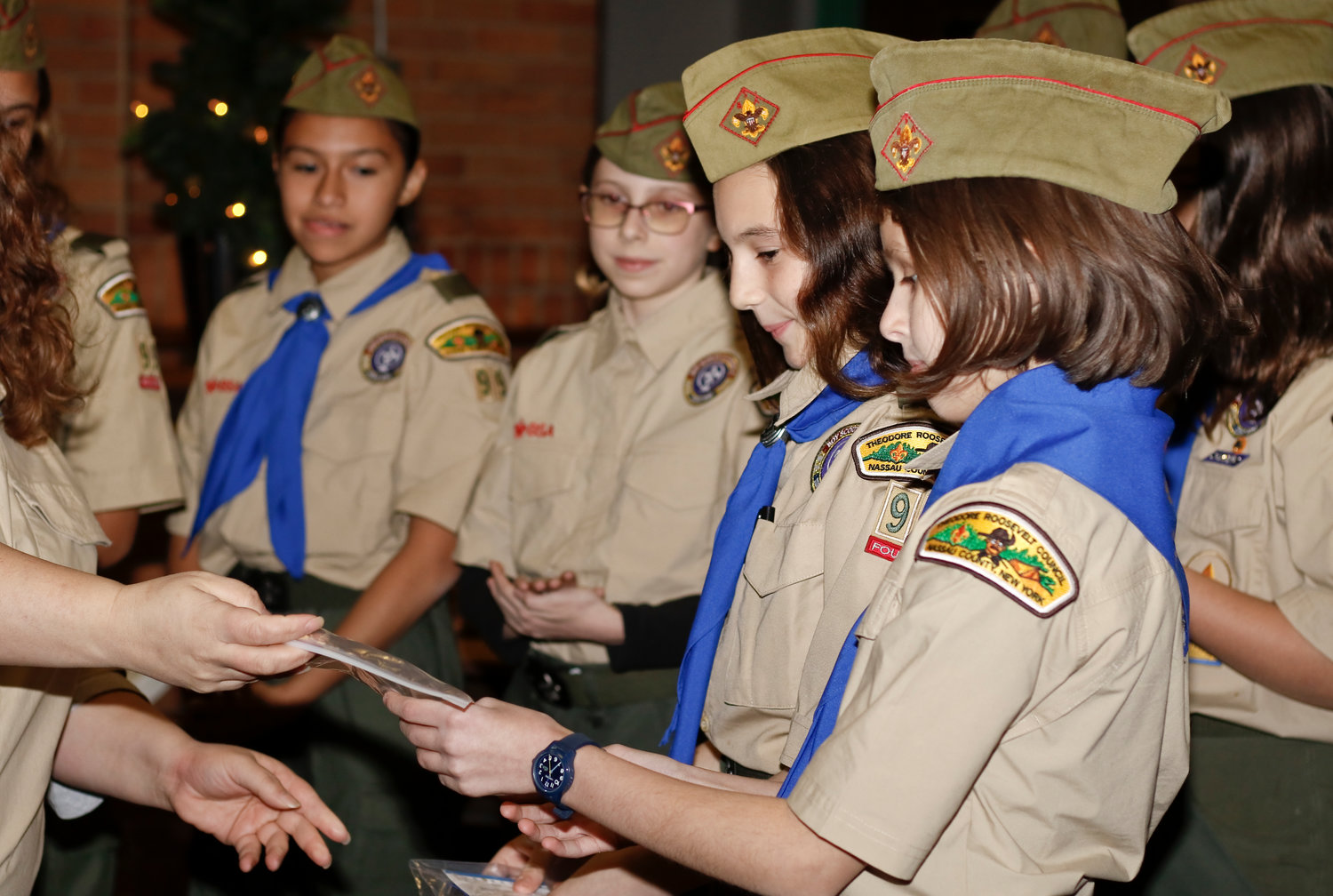 First ever Arrow of Light recipients Nina Munafo, right, and Isabella Lebron bridged over during the Court of Honor ceremony and became full fledged scouts.