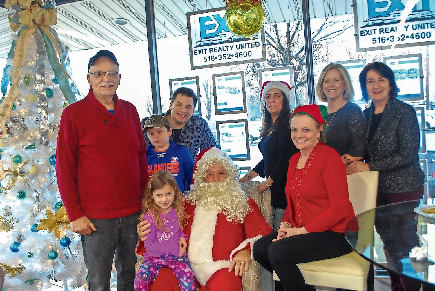 Exit Realty agents and their children took a group photo Santa left on Dec. 14.