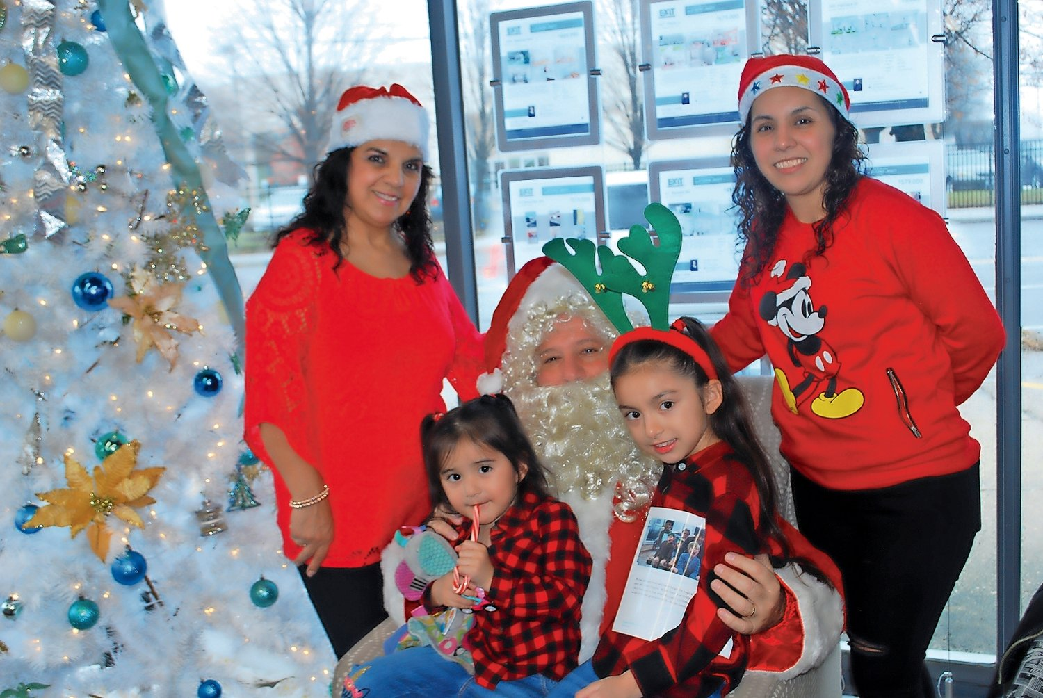 Grandmother Irma and daughter Yuliana Romero posed for a photo with Santa and kids Veronica, 3 1/2, and Catalina Ramirez, 7.
