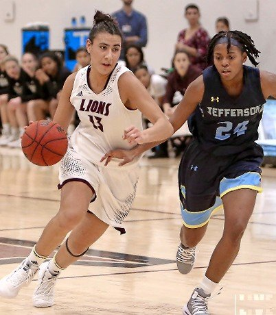 Junior Marthe Guirand, left, started 23 games for the Lady Lions and was a steady contributor on the boards (6.8 rebounds per game) and the offensive end (5.8 ppg.)