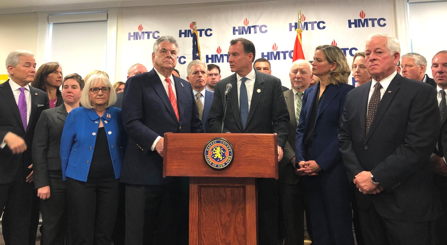 U.S. representatives Peter King and Tom Suozzi joined Nassau County Executive Laura Curran, her Suffolk County counterpart, Steve Bellone, and HMTC Chairman Steven Markowitz, third from the right, to announce the formation of an island-wide taskforce against anti-Semitism and symbols of hate at a news conference on Dec. 9.