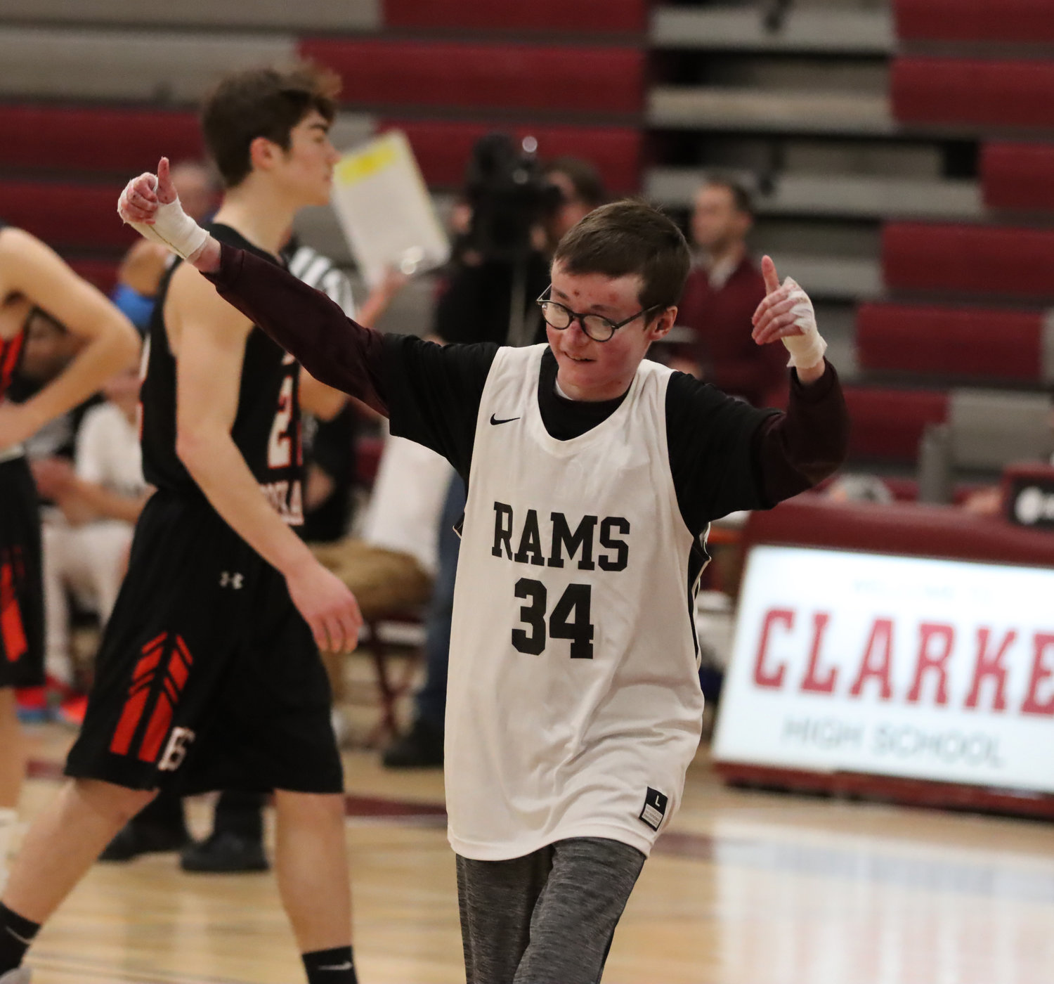 Robbie Twible ran onto the court when W.T. Clarke High School faced off against East Rockaway High School last Friday. The 17-year-old watches the games from the sidelines because he has a life-threatening skin disorder, but this time he shot, and scored.