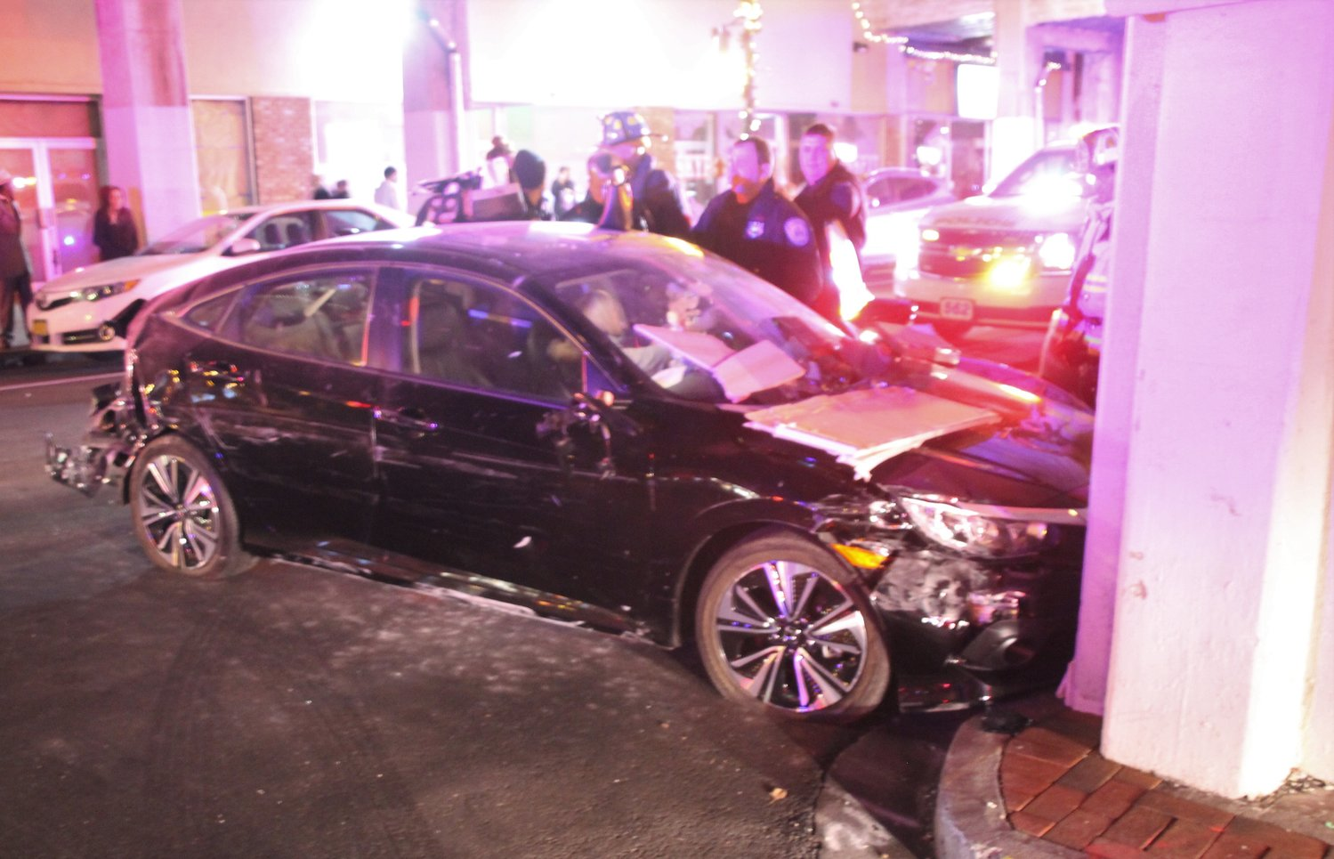 A drunk driver crashed her car into a storefront and a cement stanchion near the Lynbrook Long Island Rail Road on Sunday night.