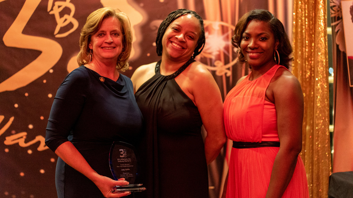 Williams, center, at the 3D's gala at the Coral House with State Assemblywoman Judy Griffin, left, and Dr. Audrey Kirkland, the organization's board president.