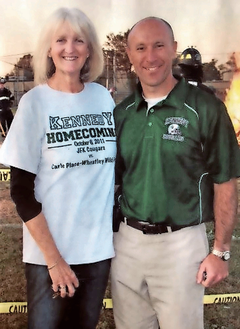 One of Current Principal Gerard Owenburg's favorite photos is of him and Poppe in front of the Kennedy fire pit at a Homecoming.