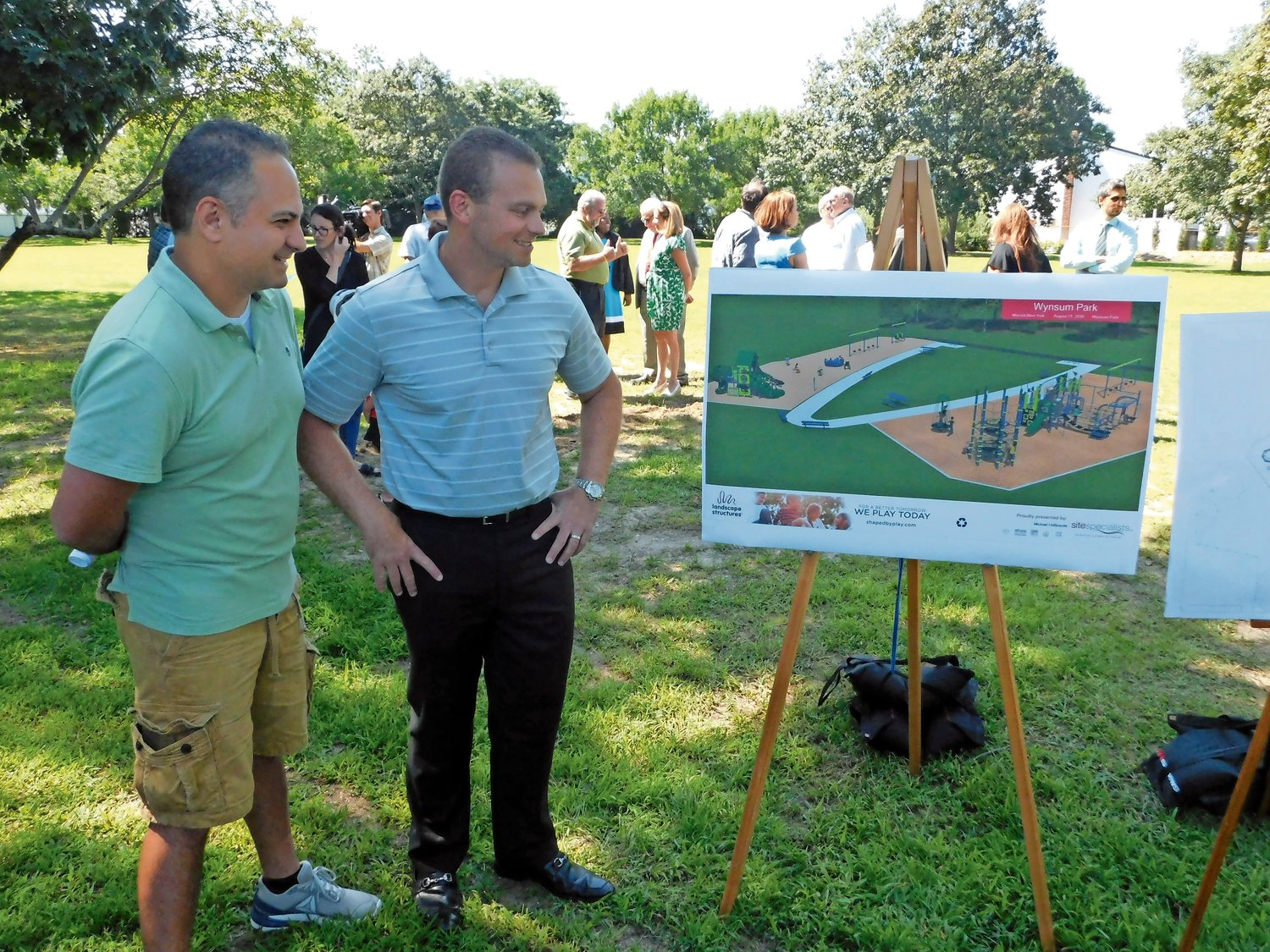 Shawn Field, left, and Jay Rogoff with the schematic of what became Wynsum Avenue playground at the project's groundbreaking.